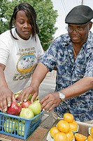 4th Avenue District, street fruit vendor, Black male. Birmingham. Alabama. USA.