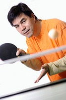 Asian man playing ping pong