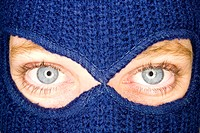A stock photograph of an attractive woman wearing a balaclava