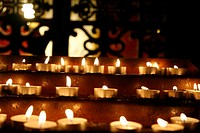 Rows of Lit Votive Candles