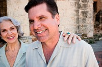 Mature man smiling with his mother looking at him