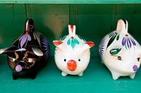 Close-up of three piggy banks