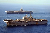 Arabian Sea (May 22, 2007)- USS John C. Stennis (CVN 74) (top) and USS Bonhomme Richard (LHD 6) steam through the Gulf of Oman. Stennis, as part of th...