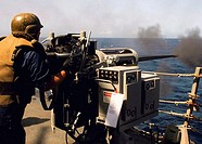 Indian Ocean (Aug. 7, 2007) - A Sailor fires a 25mm chain gun during a gun qualifications and small craft action team (SCAT) training exercise aboard ...