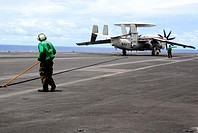 PACIFIC OCEAN (Aug. 7, 2007) - Aviation Boatswain's Mate (Equipment) Airman Albert Guzman helps retract the arresting gear on the flight deck of the n...