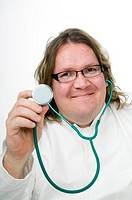 Doctor smiling while using stethoscope