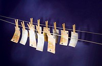Euro banknotes hanging on two rows of clotheslines