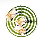 Fifty Euro banknotes pinned on a dart board
