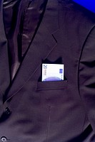 Banknote sticking out of blazer pocket