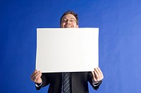 Businessman posing with a censor sheet (thumbnail)