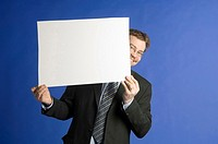 Businessman posing with a censor sheet