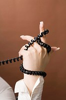 Hand tangled with telephone cord