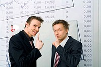 Two businessmen showing hushing sign
