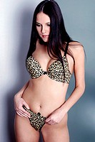 Woman in leopard print lingerie looking down