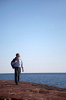 Businessman walking and enjoying the sunlight (thumbnail)