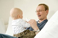 Father playing with baby (thumbnail)