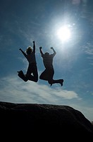 Couple jumping up in joy