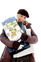 Woman smiling while carrying a heap of shopping bags