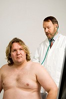 Doctor giving patient a body check up
