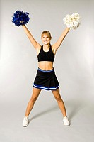 Cheerleader holding pom-poms