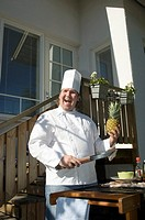Chef holding ham and pineapple