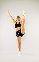 Cheerleader lifting up one leg (thumbnail)