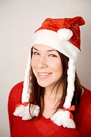 Teenage girl with santa hat smiling at the camera