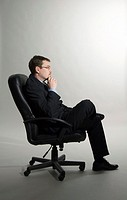 Businessman contemplating, side view
