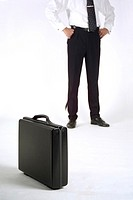 Midsection of businessman and a briefcase