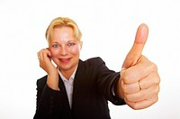 Businesswoman using mobile phone while showing thumbs up