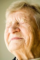 Senior woman with eyes and mouth closed (thumbnail)