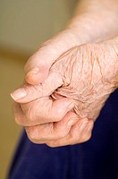 Senior woman's hands clasping together