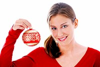 Woman holding a Christmas ball ornament (thumbnail)