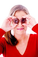 Woman posing with cookies as her eyes