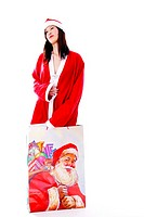 Sexy woman in santa suit,standing in a big shopping bag