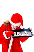 Woman smelling freshly baked cookies in a tray