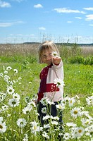 Girl holding flower