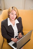 High angle view of businesswoman working on her laptop