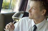 Businessman enjoying a glass of champagne (thumbnail)
