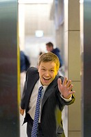 Businessman stopping an elevator