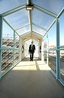 Businessman holding paperwork while walking (thumbnail)