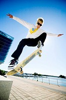 Businessman skateboarding (thumbnail)