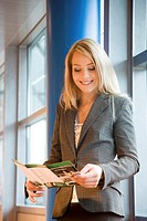 Businesswoman reading a brochure (thumbnail)