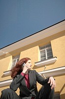 Businesswoman looking away while talking on the mobile phone