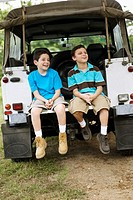Two Boys Resting at SUV