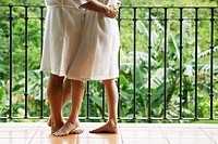 Couple in Bathrobes Embracing Outdoors