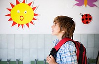 Boy in Classroom Looking at Cartoon Sun
