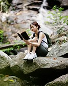 Woman Reading in Forest