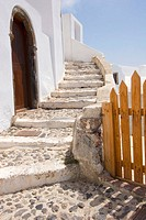Winding staircase and fence. Santorini. Greece