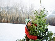 Man Holding Christmas Tree